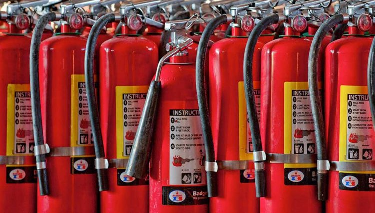 A photo collection of fire extinguishers