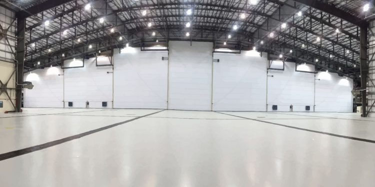 Airplane hanger containing invisible jet