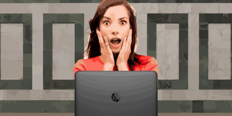 Surprised woman in front of computer
